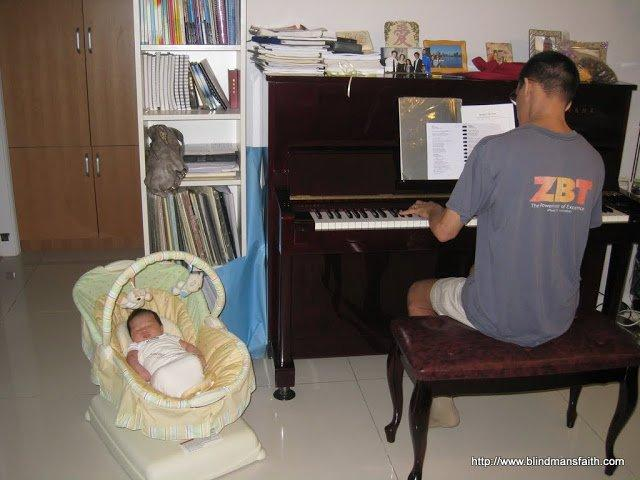 Listening to daddy play the piano