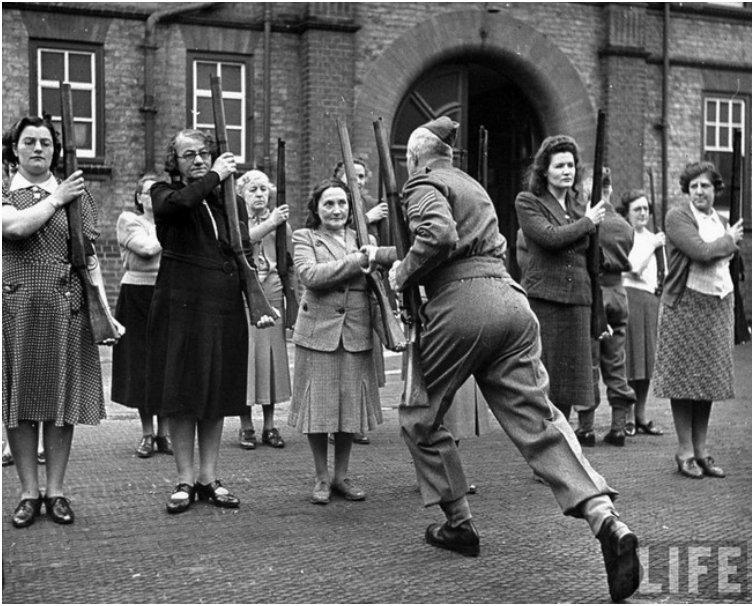 A British sergeant training members of the  mum s army  Women s Home Defence Corps during the Battle of Britain. [1940]