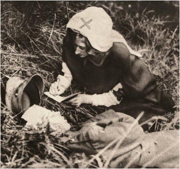 A Red Cross nurse takes down the last words of a British soldier. [c. 1917]