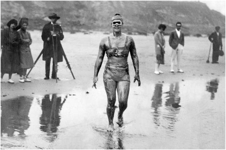Gertrude Ederle becomes the first woman to swim across the English Channel. [1926]