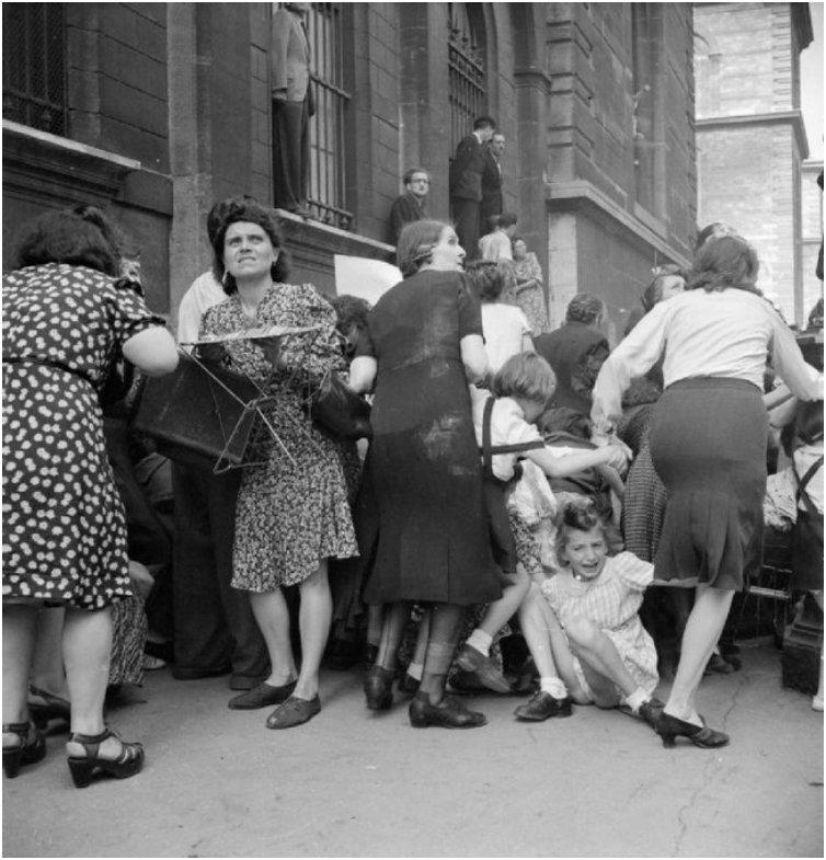 Parisian mothers shield their children from German sniper fire. [1944]
