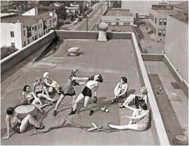 Women boxing on a rooftop in Los Angeles in the 1930s