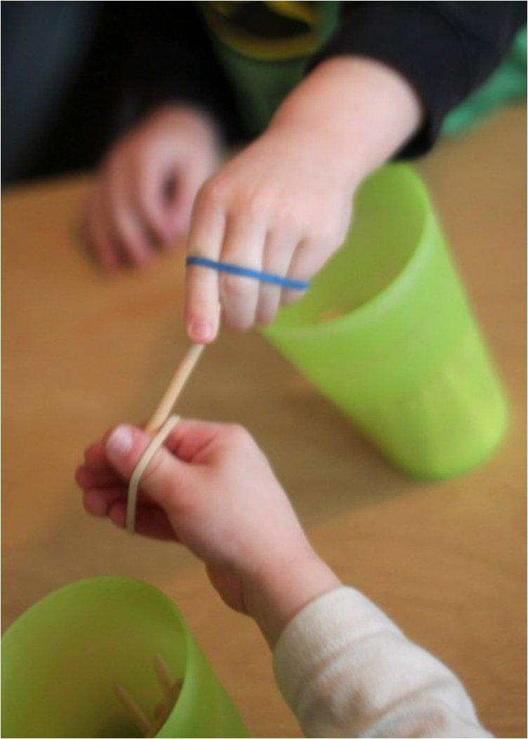 Fine Motor Activity Rubber Band Passing Game