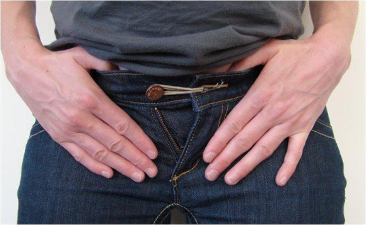 Turn regular jeans into maternity jeans with a rubber band