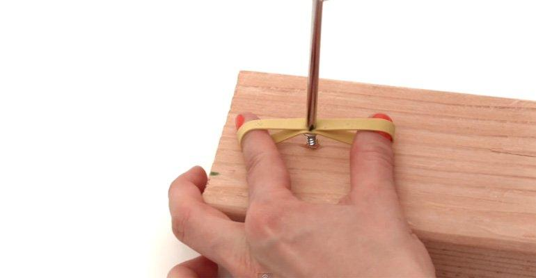 se a rubber band to remove a stripped screw