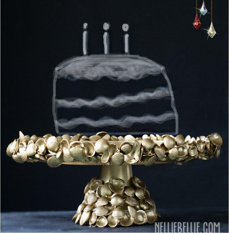 golden shell encrusted cake stand