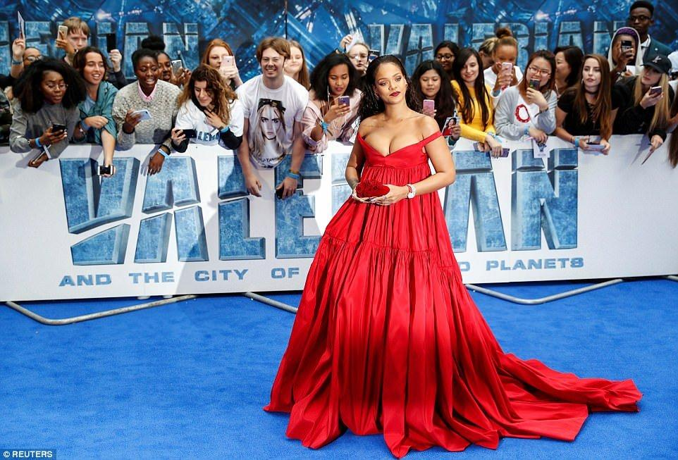 Rihanna Turns Heads In Low-Cut Scarlet Gown At Star-Studded Valerian Premiere In London