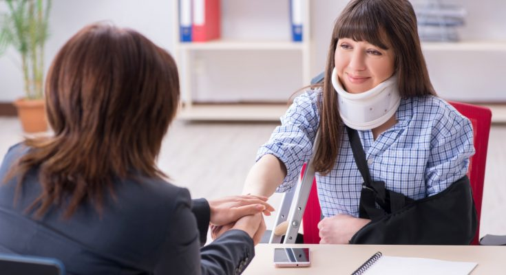 Injured employee visiting lawyer for advice on insurance attorney lawyer