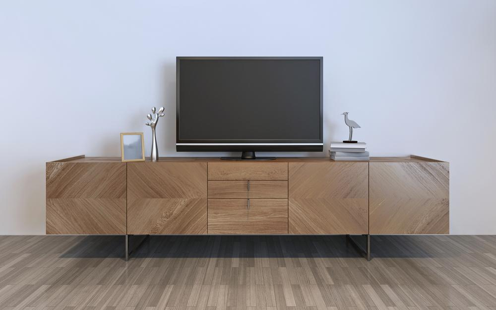 Wall mounted TV and cabinet underneath